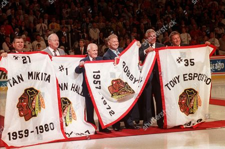 Hull Esposito Mikita Hall Ivan Former Chicago Blackhawks players Stan Mikita, left, Glenn Hall, former general manager Tommy Ivan, Bobby Hull, Bill Wirtz and Tony Esposito pose at the Chicago Stadium in Chicago, Ill., Thursday night, during a pre-game ceremony. The banners were lowered and given to the Hall of Fame players before the start of the final regular season game in the 65-year-old stadium. A new stadium is being built across the street