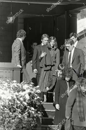 Christa McAuliffe's husband Steven, right, his son Scott, 9, center, and alternate teacher-astronaut Barbara Morgan of McCall, Idaho, join others as they leave the McAuliffe's Concord, New Hampshire home, en route to a funeral Mass for Mrs. McAuliffe who died in last week's shuttle explosion. Ms. Morgan trained with Christa McAuliffe as her alternate for the NASA project