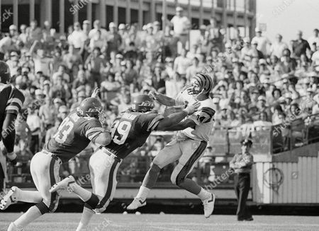 Ken Anderson, Marty Lyons, Mark Gastineau The New York Jets' Marty Lyons (93) and Mark Gastineau (99) charge the Cincinnati Bengals quarterback Ken Anderson, during the second quarter of play in New York on . The Jets lost to the Bengals 31-30