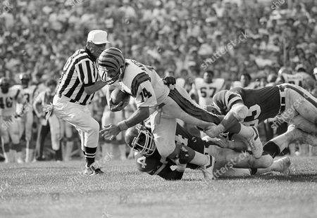 Ken Anderson, Marty Lyons, Abdul Salaam The Cincinnati Bengals quarterback Ken Anderson (14) is stopped during the second quarter by the New York Jets' Abdul Salaam (74) and Marty Lyons (93) for short yardage in New York on