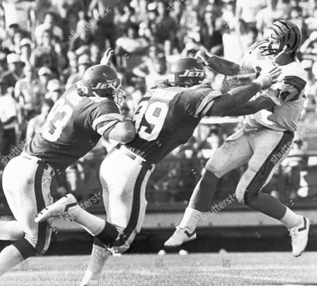 Marty Lyons, Mark Gastineau The New York Jets' Marty Lyons (93) and Mark Gastineau (99) charge the Cincinnati Bengals quarterback Ken Anderson during the second quarter of play in New York