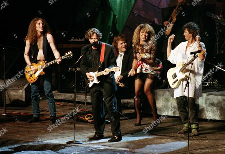 Stock Photo of Turner Clapton Richards Rolling Stones' guitarist Keith Richards, singer Tina Turner, guitarist Jeff Healy, guitarist Eric Clapton and guitarist Waddy Wachtel, from right to left, perform while taking part in an all-star jam to close the first International Rock Awards ceremony in New York City, Wednesday night