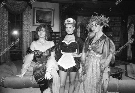 "Lesley Ann Warren, Colleen Camp and Eileen Brennan stand on the set of the movie ""Clue"