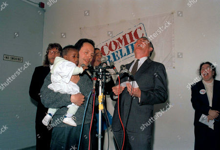 Flynn Cooper Crystal Boston Mayor Raymond Flynn, right, gives a hearty laugh during a news conference with comedian Billy Crystal, holding seven-month-old Joshua Cooper, during a check presentation of $77,000 from the Comic Relief Fund for the homeless in Boston, . Joshua lives in a downtown Boston hotel for the homeless with his mother