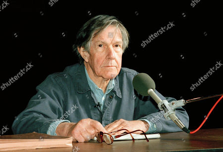 Famed avant-garde composer and poet John Cage lectures at Sanders Theater at Harvard University in Cambridge, Mass. Cage, 76, has been honored by Harvard with the post of Charles Eliot Norton Professor of Poetry
