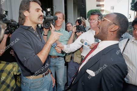 Stock Image of Rich McGready, Morris Griffin Rich McGready, left, and Morris Griffin argue over the verdicts in the Reginald Denny beating trial, and surrounding social issues, outside Superior Court in Los Angeles on . The jury will continue deliberations on Wednesday on two remaining deadlocked counts against co-defendants Damian Williams and Henry Watson