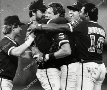 Chicago Cubs players, left to right, Ron Cey, Rick Sutcliffe, Jody Davis, Ryne Sandberg and Leon Durham celebrate after the Cubs clinched the National Leagues Eastern Division Championship, Pittsburgh, Pa. The Cubs beat the Pirates 4-1 behind a 2 hitter by Rick Sutcliffe to win their first Championship in 39 years