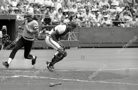 Dale Berra, Jamie Quirk Pittsburgh Pirates Dale Berra slips in behind St. Louis Cardinals catcher Jamie Quirk to score during the 4th inning at St. Louis on . Berra followed Dave Parker home when pitcher Don Robinson singled to right field. Cardinals David Green had trouble coming up with the ball and both men scored