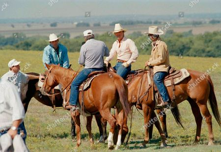 """Cast members of the television show """"Dallas,"""" Howard Keel, left, George Kennedy, center, and Patrick Duffy take a break from filming the popular show on location in Prosper, Texas on . Kennedy has joined the cast as Carter McKay to cause more conflict in the lives of the """"Dallas"""" characters"""