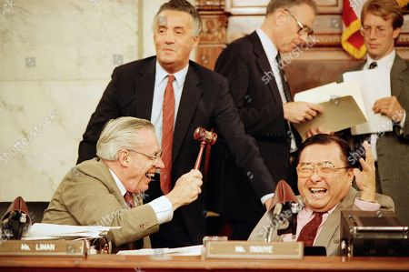 Rep. William Broomfield, R-Mich., left, pretends to rap Sen. Daniel Inouye, D-Hawaii, chairman of the Senate project panel investigating the Iran-Contra affair, on the head while Sen. Paul Sarbanass, D-Md., watches during a break in the Iran-Contra hearings on Capitol Hill in Washington . The committee heard testimony from Attorney General Edwin Meese III