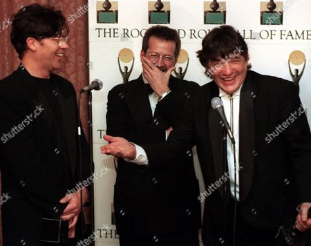 Stock Picture of DANKO ROBERTSON CLAPTON Members of The Band, Rick Danko, right, and Robbie Robertson, left, share a light moment with Eric Clapton, center, backstage following the legendary group's Rock and Roll Hall of Fame induction ceremony at New York's Waldorf Astoria in this photo