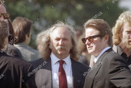 David Crosby, left, and Don Henley share a moment together after funeral services for drummer Jeff Porcaro of the Grammy-award winning band Toto in Los Angeles, . Also attending were rock' n' rollers Jackson Browne, Graham Nash, and Bonnie Raitt, who were among the more than 1,600 people at the public service. Porcaro died of an apparent heart attack on August 5