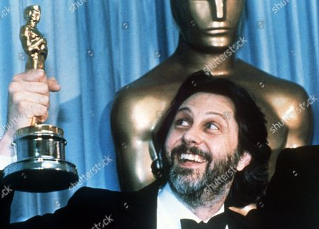 Britain's David Putnam, producer of the 1981 film 'Chariots of Fire', holds up his Oscar after the movie was named Best Picture of the year in Los Angeles, . The movie won a total of four Academy Awards