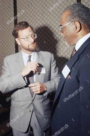 David Rockefeller, Jr., left, vice chairman of Rockefeller Family and Associate, talks to Rev. Samuel McKinney, of the Leadership Council, right in Seattle on prior to speaking at the Washington gives luncheon