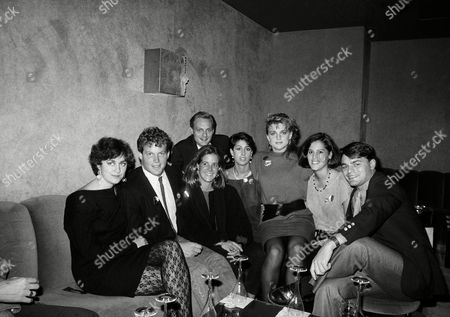 Stock Picture of Sons and daughters of Democratic political candidates and office holders crowd together for a photo during a campaign fundraiser at a disco, New York. Shown are, left to right, Maura Moynihan daughter of NY Sen. Daniel Patrick Moynihan, Sen. Edward Kennedys children Ted Kennedy Jr. and Kara Kennedy, Ted Mondale son of Walter Mondale, Donna Zaccaro daughter of Geraldine Ferraro, Eleanor Mondale, Laura Zaccaro and William Mondale