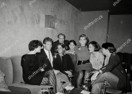 Stock Image of Sons and daughters of Democratic political candidates and office holders crowd together for a photo during a campaign fundraiser at a disco, New York. Shown are, left to right, Maura Moynihan daughter of NY Sen. Daniel Patrick Moynihan, Sen. Edward Kennedys children Ted Kennedy Jr. and Kara Kennedy, Ted Mondale son of Walter Mondale, Donna Zaccaro daughter of Geraldine Ferraro, Eleanor Mondale, Laura Zaccaro and William Mondale