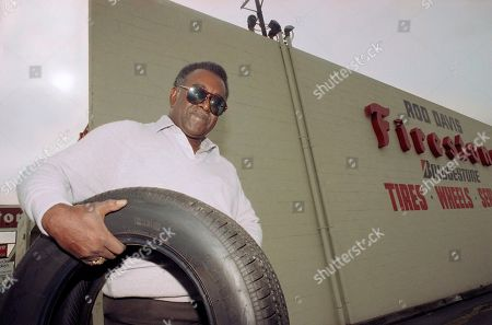 Rod Davis Sr., whose Firestone tire store was destroyed in last year?s riots in South Central Los Angeles, stands outside his newly-rebuilt tire store in Westchester, six miles west of his last store which remains a barren slab of concrete on