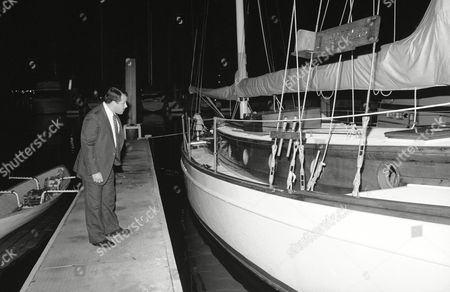 Unidentified investigator looks at the yawl Emerald at boat slip in Marina Del Rey near Los Angeles on . Earlier, Beach Boys band member Dennis Wilson apparently drowned in a swimming accident from the boat. Wilson was 39