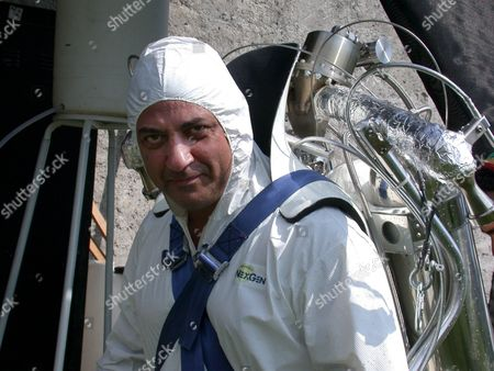 A Daredevil Inventor Has Released the World's First Commercially Available James Bond Style Rocket Pack - and it Can be Yours for Just £130,000. Dubbed 'Rocket Belts' the Hydrogen-Peroxide Powered Packs Can Propel the Wearer to Speeds of Up to 60 Miles Per Hour. Pictured, Inventor Juan Manuel Lozano Wearing His Jet Belt Pack and About to Take to the Skies.