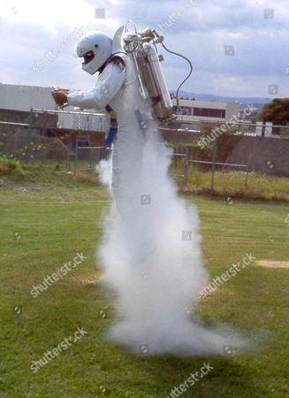 Stock Image of Dubbed 'Rocket Belts' the Hydrogen-Peroxide Powered Packs Can Propel the Wearer to Speeds of Up to 60 Miles Per Hour. Pictured, Inventor Juan Manuel Lozano Making One of the First Test Flights in the Rocket Belt.