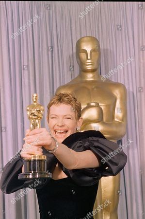 """Stock Image of Dianne Wiest breaks out in big grins as she proudly displays the Oscar she received for best supporting actress during the 59th Annual Academy Awards in Los Angeles. Ms. Wiest received her honor for her portrayal in """"Hannah and her Sister"""
