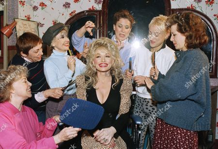 Dolly Parton, Elizabeth Moore, Mary Fogarty, Rosemary Prinz, Susan Masur, Connie Shulman, Betsey Aidem Dolly Parton, who is slated to appear in the film version, gets a mass hairdo as she visits the Broadway show ?Steel Magnolias? in New York, . Giving Dolly the business are, from left: Elizabeth Moore, Mary Fogarty, Rosemary Prinz, Susan Masur, Connie Shulman and Betsey Aidem