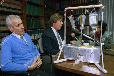 Stock Picture of Jack Kevorkian Retired Royal Oak, Mich. pathologist, Dr. Jack Kevorkian, 62, (left) listens as his attorney, Geoffrey N. Fieger, talks with reporters, after return of the ?Suicide Machine.? Dr. Kevorkian said he vas discussing the details of suicide with a 44-year-old dentist, despite an Oakland County Mich. Circuit Curt injunction by Judge Alice Gilbert