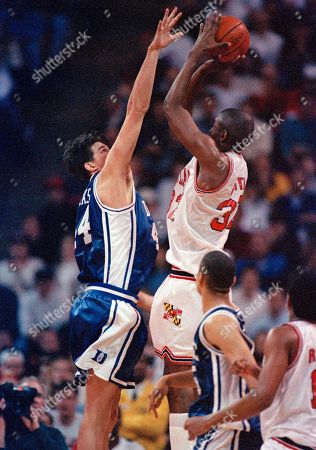 Joe Smith, Tony Moore Duke University's Cherokee Parks, left, goes up to block University of Maryland's Joe Smith as Duke's Tony Moore watches in the first half of their game in College Park, Md., . Duke held off Maryland to win 73-69