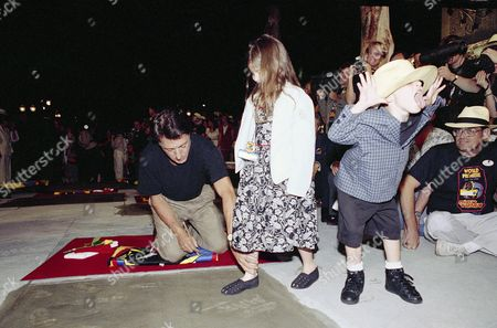 Dustin Hoffman, Max Hoffman, Becky Hoffman Max Hoffman, 5-year-old son of actor Dustin Hoffman makes faces at photographers while Dustin helps daughter Becky leave her footprint in concrete during world premiere ceremonies for the Dick Tracy movie outside the Grauman's Chinese Theater at Disney/MGM Studio in Lake Buena Vista on