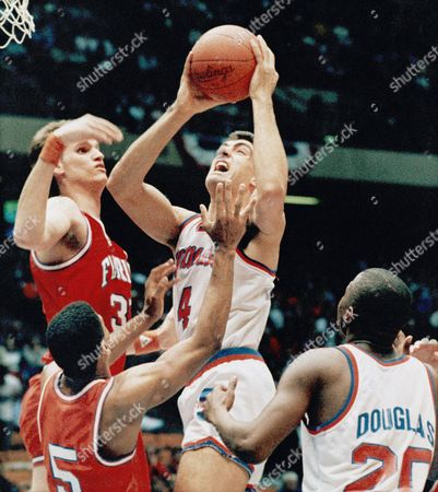 Rony Seikaly, Dwayne Schintzius Syracuse's Rony Seikaly shoots one of his 33 points over Florida's Dwayne Schintzius during their NCAA Eastern Regional game at the Meadowlands Arena in East Rutherford, N.J., on