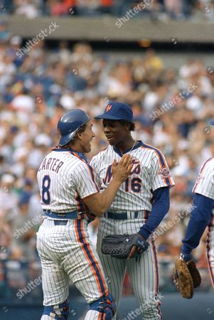 Dwight Gooden, Gary Carter New York Mets pitcher Dwight Gooden is congratulated by catcher Gary Carter, left, after he won his 14th game beating the San Diego Padres 7-1 in the first game of a double header at Shea Stadium in New York, . Carter had the game winning hit, his 15th of the season