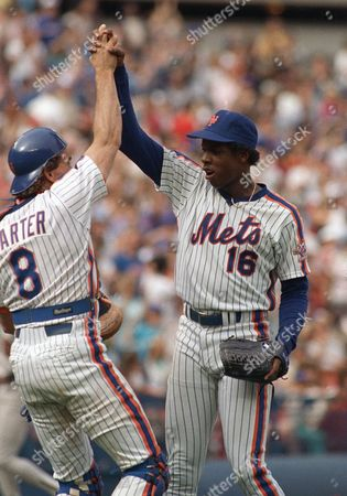 Dwight Gooden, Gary Carter New York Mets pitcher Dwight Gooden high fives catcher Gary Carter, left, after pitching a complete game 7-1 win over the San Diego Padres for his 14th win over the season-a four hitter in New York, . Carter had the game winning his 15th of the season