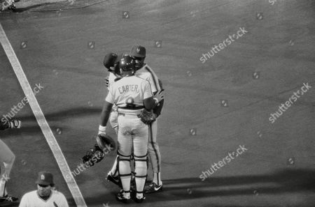 Dwight Gooden, Gary Carter, Howard Johnson New York Mets' pitcher Dwight Gooden, right, is congratulated by catcher Gary Carter and third baseman Howard Johnson after defeating the St. Louis Cardinals 5-2 in St. Louis, . The win pulled the Mets to within gone game of the Cardinals