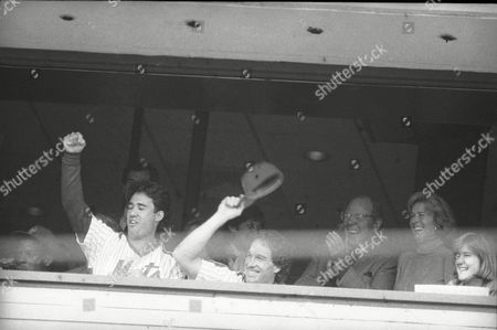 Dwight Gooden, Ron Dar, Gary Carte New York Mets players Dwight Gooden, Ron Dar and Gary Carter wave to the fans cheering them as they sit and watch the Mets game the Montreal Expos from the owners box on the fourth level of New York's Shea Stadium, . All sat out the final game of the season as the Cardinals had won the NL East title on Saturday
