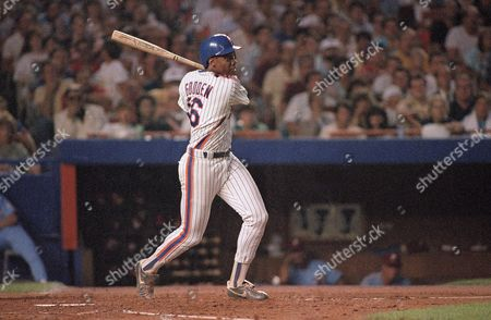 Dwight Gooden New York Mets pitcher Dwight Gooden watches the trajectory of his hit in the second inning of the game against the Philadelphia Phillies it Shea Stadium in New York, . Gooden hit in Gary Carter for an RBI