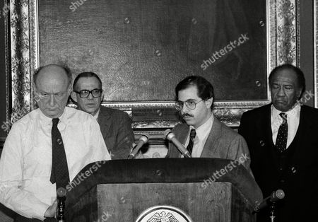 Stock Picture of Officials stand at the podium at City Hall, as they announce the findings of reports released on an incident in which an apparently emotionally disturbed woman, Eleanor Bumpurs, was shot to death by a police officer on Oct. 29, when she allegedly attacked officers with a knife, New York. From left to right are New York Mayor Ed Koch, Human Resources Commissioner George Gross, Victor Botnick, Special Adviser to the Mayor, and New York Police Commissioner Benjamin Ward