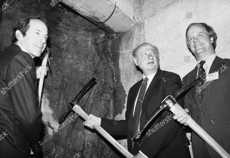 Mayor Ed Koch ground on construction of an underpass at Lexington Avenue on in New York which will let subway passengers transfer between the Lexington Avenue subway and the E and F trains linking the West Side of Manhattan to Queens. The tunnel is due for completion in 1987. Flaking Koch are Mort Zuckerman, chairman of Boston Properties, left, and Ralph Stanley, administrator of the Urban Mass Transit Systems