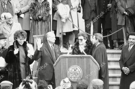 New York's Mayor Edward I. Koch raises his right hand during inaugural ceremonies in Manhattan, in New York. Koch was sworn in for a third term on the steps of City Hall. New York State Judge Sol Wachtler, right, issued the oath while New York City Department of Cultural Affairs Commissioner Bess Myerson, left, listens. Second from right is Koch's Sister Pat Thayler