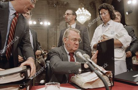 "Edwin Meese Attorney General Edwin Meese III appears before the con investigating the Iran-Contra affair on Capitol Hill in Washington on . Testifying under oath and without is at the nationally televised hearings, Meese said ""my own counsel"" was to support the secret sale of to Iran when his opinion was asked in January 1986"