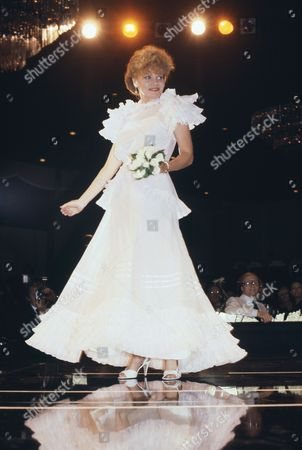 Actress Brennan Eileen models clothes at a gala in Hollywood where stars wore original costumes in honor of the designers, Oct. 1982