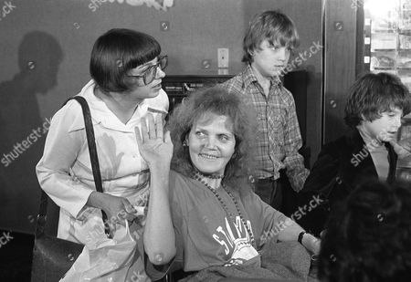 Emmy Award-winning actress Eileen Brennan is wheeled out of a Los Angeles hospital, accompanied by her son, Sam Lampson, right, after spending almost eight weeks there for treatment of injuries suffered when the actress was struck by a car on a Venice, Calif. street. Ms. Brennan underwent major surgery twice to stabilize fractures she received in the legs and face
