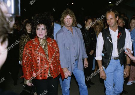 Actress Elizabeth Taylor and her husband Larry Fortensky arrive for the benefit performance of Cirque Du Soleil's Saltimbanco on in Santa Monica, Calif. All proceeds from the event will go to the Elizabeth Taylor AIDS Foundation