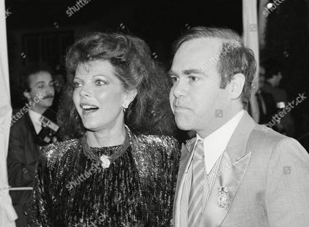 Actress Samantha Eggar and singer Elton John arrive at a star-studded dinner honoring the Queen of England at 20th Century-Fox Studios in Los Angeles, . Hundreds of Hollywood personalities came out to honor Queen Elizabeth II and Prince Phillip during their southern California visit
