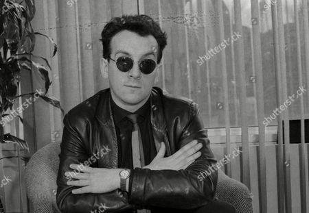 Stock Image of Elvis Costello, Declan Patrick MacManus Singer/songwriter Elvis Costello is pictured in his hotel room in New York City