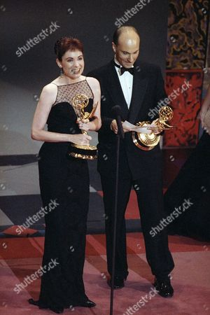 """Diane Frolov and Andrew Schneider accept their Emmy awards for Best Writing in a Drama Series for an episode of """"Northern Exposure"""" at the 44th annual Emmy Awards, at the Pasadena Center. """"Northern Exposure"""" garnered six Emmys in all, including Best Drama Series, an award for supporting actress Valerie Mahaffey, and three technical awards"""