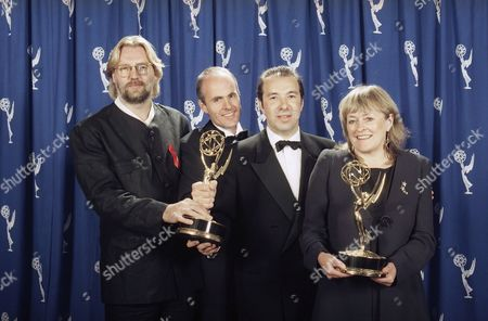 """Allan Cubitt, John Strickland, producer Paul Marcus and executive producer Sally Head of the television show """"Mystery-Prime Suspect 2,"""" display their awards after winning Outstanding Miniseries at the 45th Annual Emmy Awards in Pasadena Calif"""