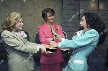 """No, the tugging is over a daytime Emmy as nominees Cadie McClain, left, and Alla Korot help announce the this year's nominees with actress Colleen Zenk Pinter, center, in New York on . The soap opera stars perform on """"All My Children,"""" """"As The World Turns"""" and """"Another World"""" respectively"""