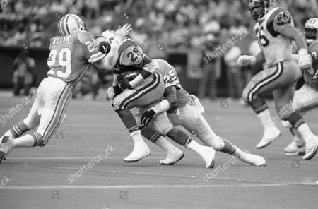 Eric Dickerson, Patrick Allen, Keith Bostic Houston Oilers' Patrick Allen (29) and Keith Bostic put the clamps on Los Angeles running back Eric Dickerson (29) in the fourth quarter, Houston, Tex. The Oilers defeated the Rams 20-16