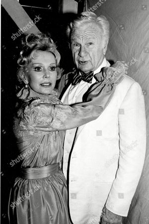 """Albert Gabor Actress Eva Gabor and actor Eddie Albert pose at the Plymouth Theatre in New York City, . Gabor and Albert appear together in the Broadway revival """"You Can't Take It With You"""