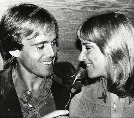 Tennis star Chris Evert-Lloyd, right, sniffs a rose offered by her husband John Lloyd, after a press conference at a Boston, Mass. hotel to promote the Boston stop on the Avon Championship Tennis Tour. Evert-Lloyd is the defending champion in the event, which begins March 15